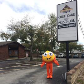 Bubbles Standing Happily in Front of the Child Care and Preschool