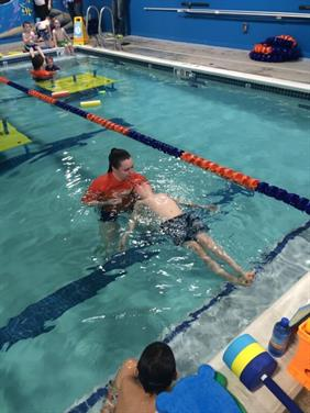Swim instructor teach a student how to float