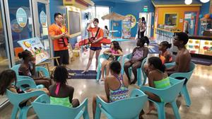 Girl Scouts Participating In Goldfish Swim School's W.A.T.E.R. Safety Program