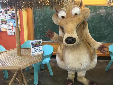Photo of Scrat Standing by a Table