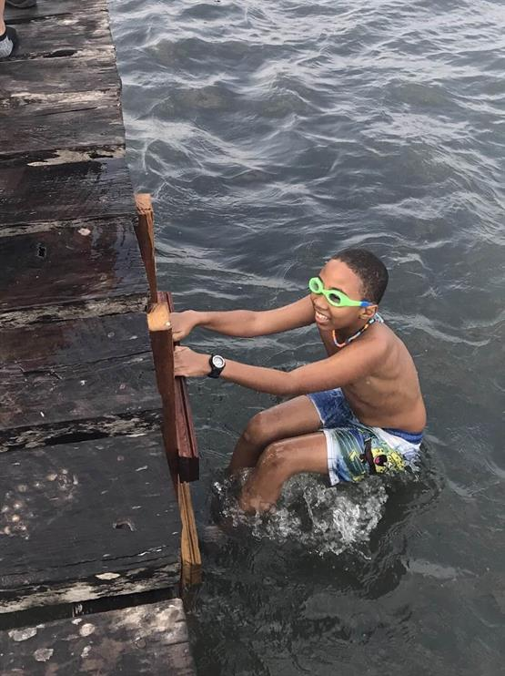 Student Having Fun In The Water In Belize