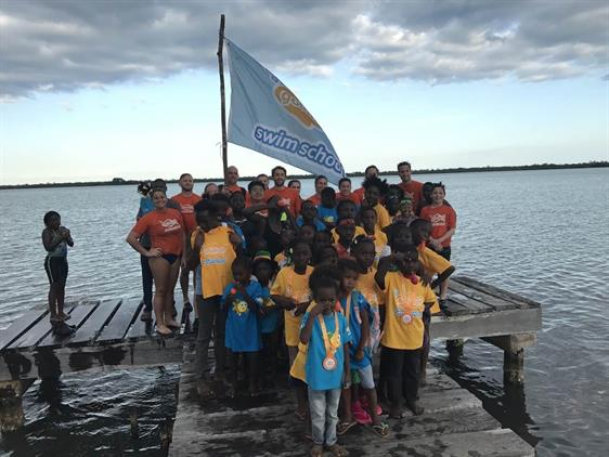 Goldfish Swim School Staff On The Deck With Belize Students
