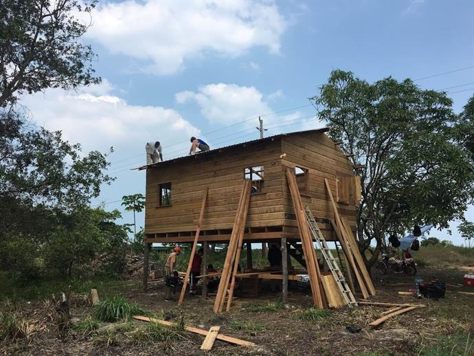 Goldfish Swim School Staff Helps Build Houses In Belize