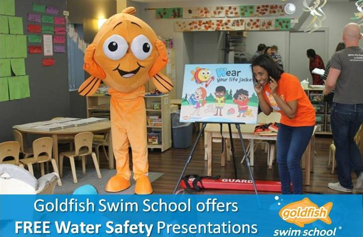 Bubbles and instructor teach a water safety class