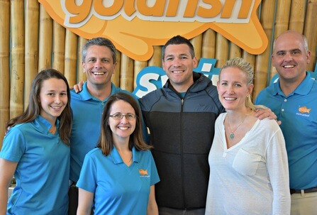 Chris and Jenny McCuiston with the owners of Goldfish Swim School Braintree